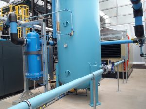 "Large compressed air pipe system connecting dryer to receiver via a 6"" flanged filter"